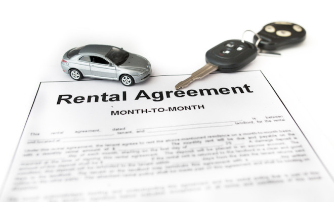 Car rental agreement with car on center