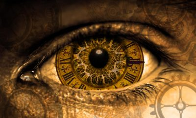 clock reflecting in the eye