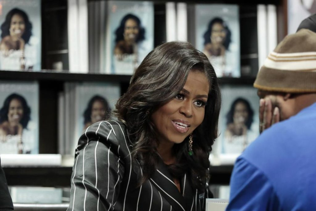 Michelle Obama signs book