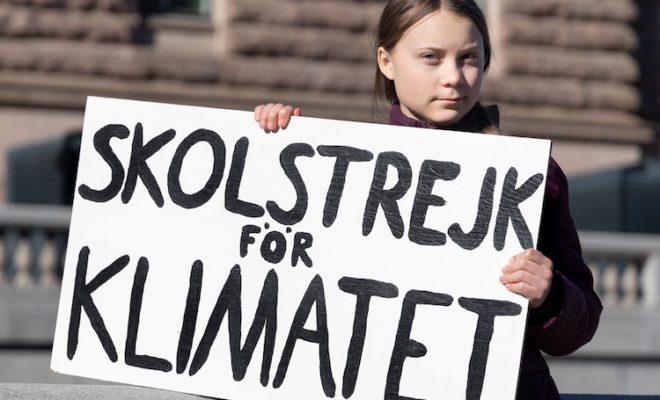 Greta Thunberg climate protest sign